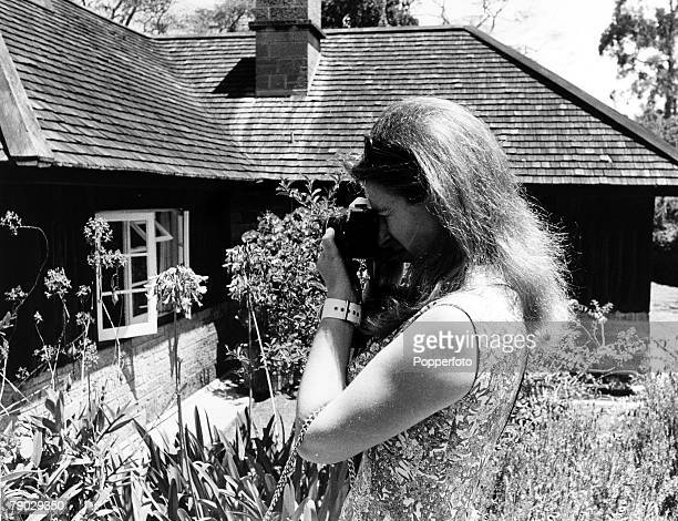 Nyeri Kenya Africa 11th February 1971 Princess Anne photographs a flower in the garden during a break in her Kenyan Royal Tour
