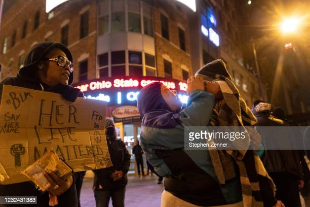 Nygeria Rahmon of Columbus, Ohio holds her one year old child at a protest outside of the Ohio Statehouse in reaction to the shooting of Makiyah...