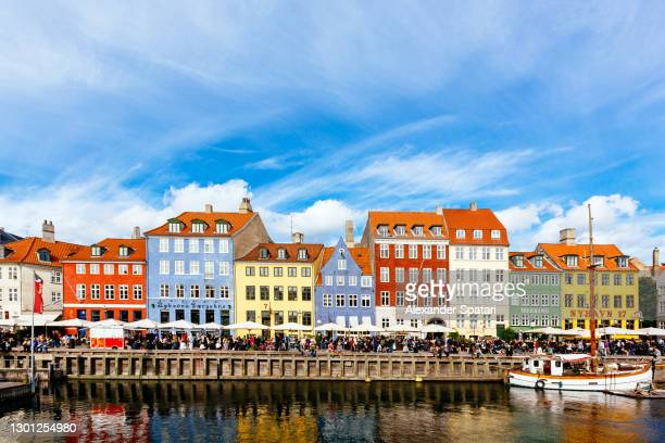 nyhavn harbor on a sunny day with blue sky, copenhagen, denmark - copenhagen stock pictures, royalty-free photos & images