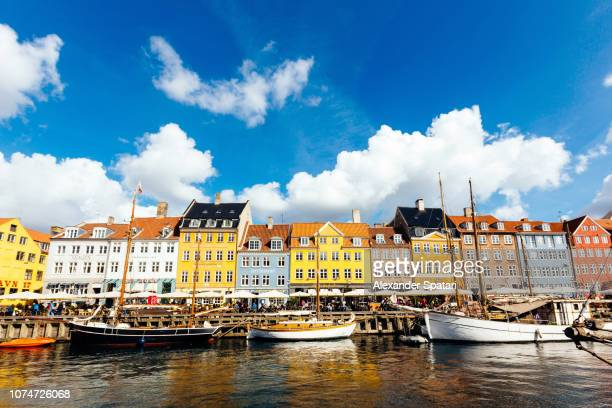 nyhavn harbor with multi-colored historical houses in copenhagen, denmark - nyhavn stock pictures, royalty-free photos & images