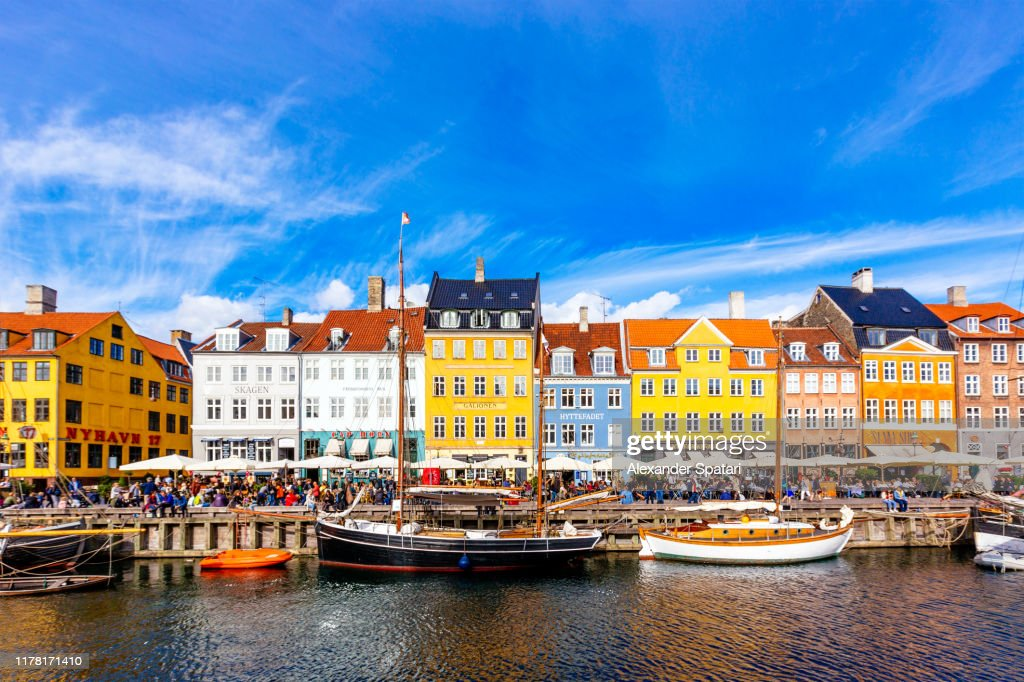 Nyhavn harbour and multicolored vibrant houses along the canal, Copenhagen, Denmark : Stock Photo