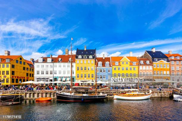 nyhavn harbour and multicolored vibrant houses along the canal, copenhagen, denmark - nyhavn stock pictures, royalty-free photos & images
