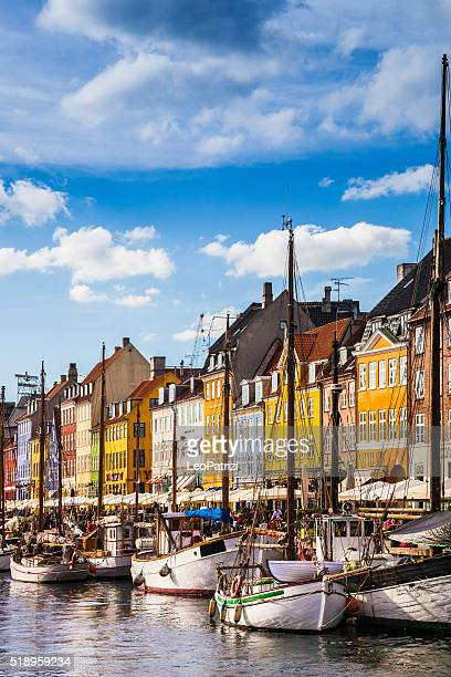 nyhavn historic copenhagen harbor - copenhagen stock pictures, royalty-free photos & images