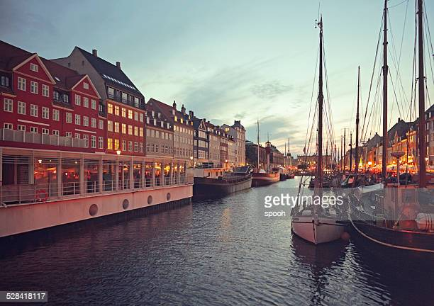 Nyhavn in Copenhagen, Denmark at dusk.