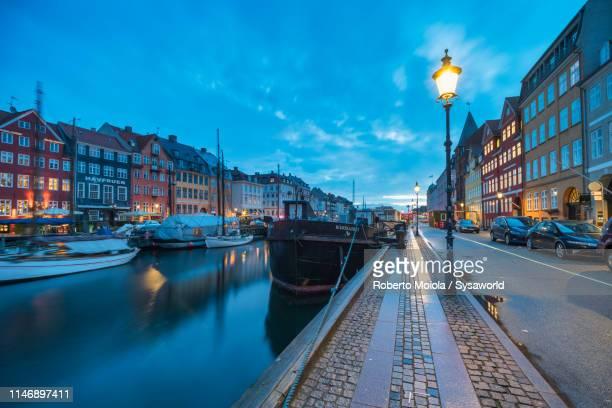 nyhavn waterfront (new harbour), copenhagen - copenhagen stock pictures, royalty-free photos & images