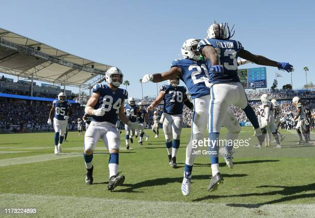 Nyheim Hines and TY Hilton of the Indianapolis Colts celebrate Hilton's touchdown against the Los Angeles Chargers in the fourth quarter at Dignity...