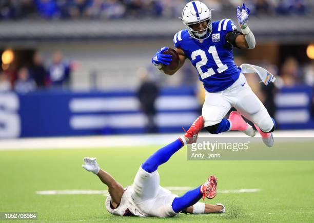 Nyheim Hines of the Indianapolis Colts runs the ball in the fourth quarter against the Buffalo Bills at Lucas Oil Stadium on October 21 2018 in...