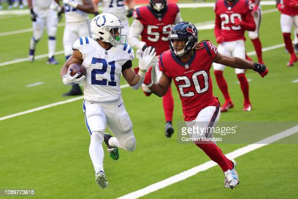 Nyheim Hines of the Indianapolis Colts scores a five-yard rushing touchdown past Justin Reid of the Houston Texans during the first half at NRG...