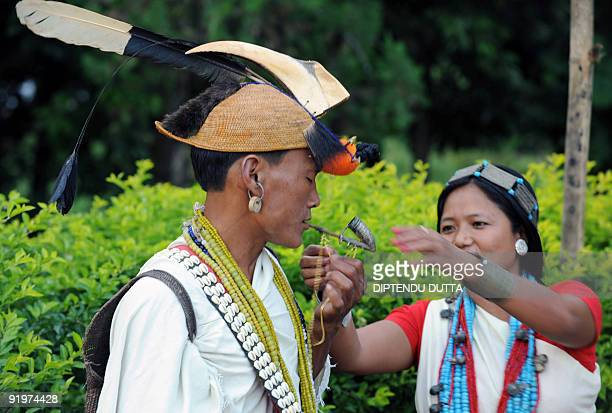 A Nyishi tribesman is seen wearing headgear made out of the beak and feathers of a hornbill at a village near Itanagar the capital city of...