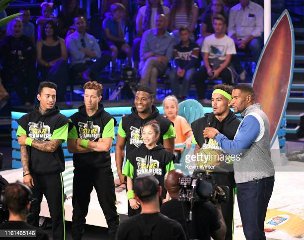 Nyjah Huston Shaun White Kel Mitchell Alysa Liu Trae Young and host Michael Strahan speak onstage during Nickelodeon Kids' Choice Sports 2019 at...