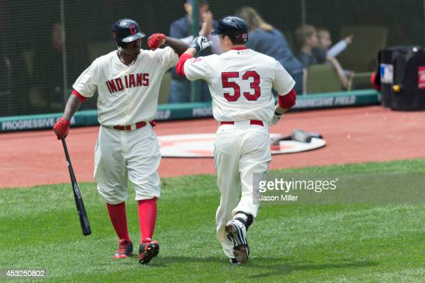 Nyjer Morgan celebrates with George Kottaras of the Cleveland Indians after Kottaras hit a solo home run during the third inning against the Chicago...