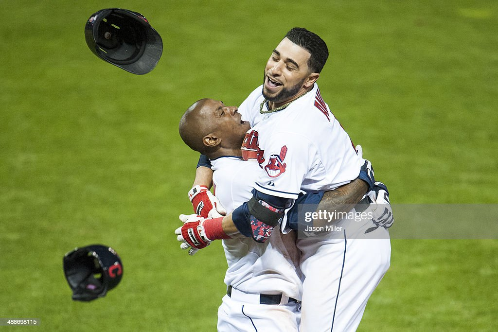 Nyjer Morgan #6 celebrates with Mike Aviles #4 of the Cleveland Indians after Aviles hit a walk-off single to center to defeat the Minnesota Twins at Progressive Field on May 7, 2014 in Cleveland, Ohio. The Indians defeated the Twins 4-3.