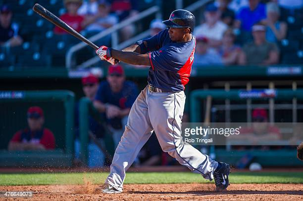 Nyjer Morgan of the Cleveland Indians bats during a spring training game against the Cincinnati Reds at Goodyear Ballpark on February 27 2014 in...