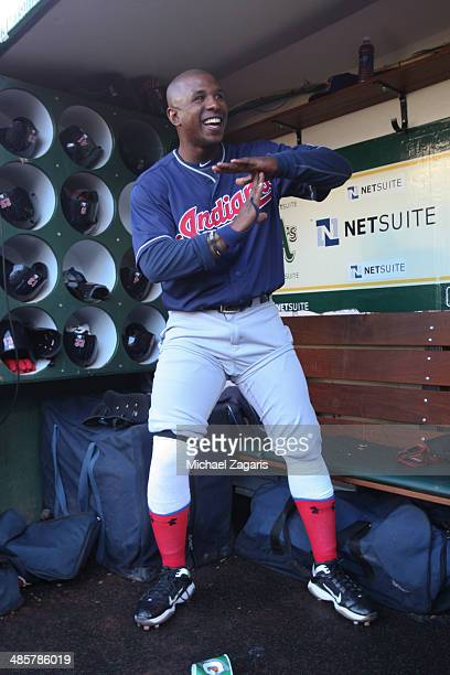 Nyjer Morgan of the Cleveland Indians flashes a T sign for Tony Plush in the dugout prior to the game against the Oakland Athletics at Oco Coliseum...