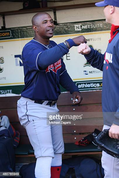 Nyjer Morgan of the Cleveland Indians gives out fist bumps in the dugout prior to the game against the Oakland Athletics at Oco Coliseum on April 2...