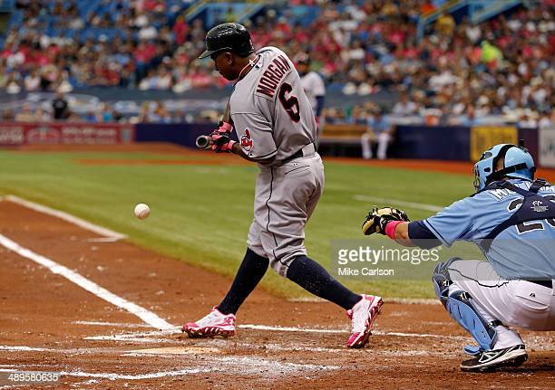 Nyjer Morgan of the Cleveland Indians hits an RBI single on a check swing in front of catcher Jose Molina of the Tampa Bay Rays in the second inning...