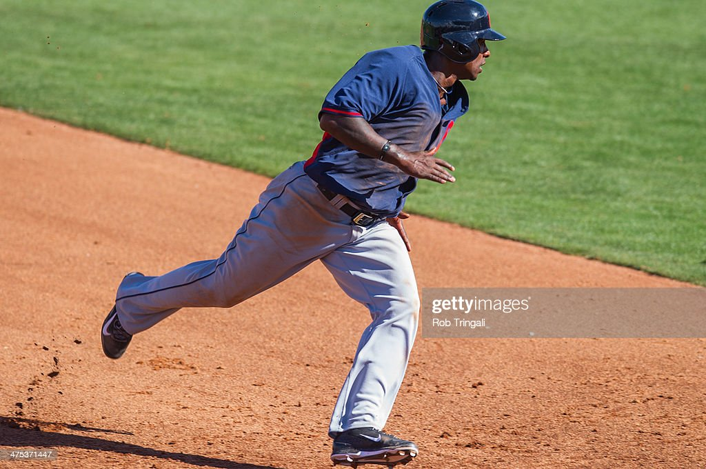 Nyjer Morgan #6 of the Cleveland Indians runs the bases during a spring training game against the Cincinnati Reds at Goodyear Ballpark on February 27, 2014 in Goodyear, Arizona.