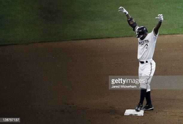 Nyjer Morgan of the Milwaukee Brewers celebrates with his team's 'Beast Mode' ritual after sliding safely into second base against the Arizona...