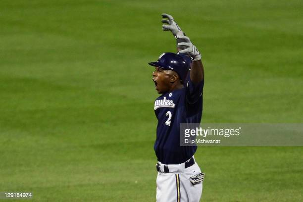 Nyjer Morgan of the Milwaukee Brewers gestures after he doubled in the top of the fifth inning against the St Louis Cardinals during Game 4 of the...