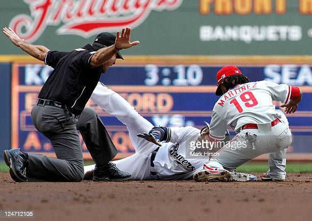 Nyjer Morgan of the Milwaukee Brewers is safe at second base on a double under the tag of Michael Matrinez during game action against the...