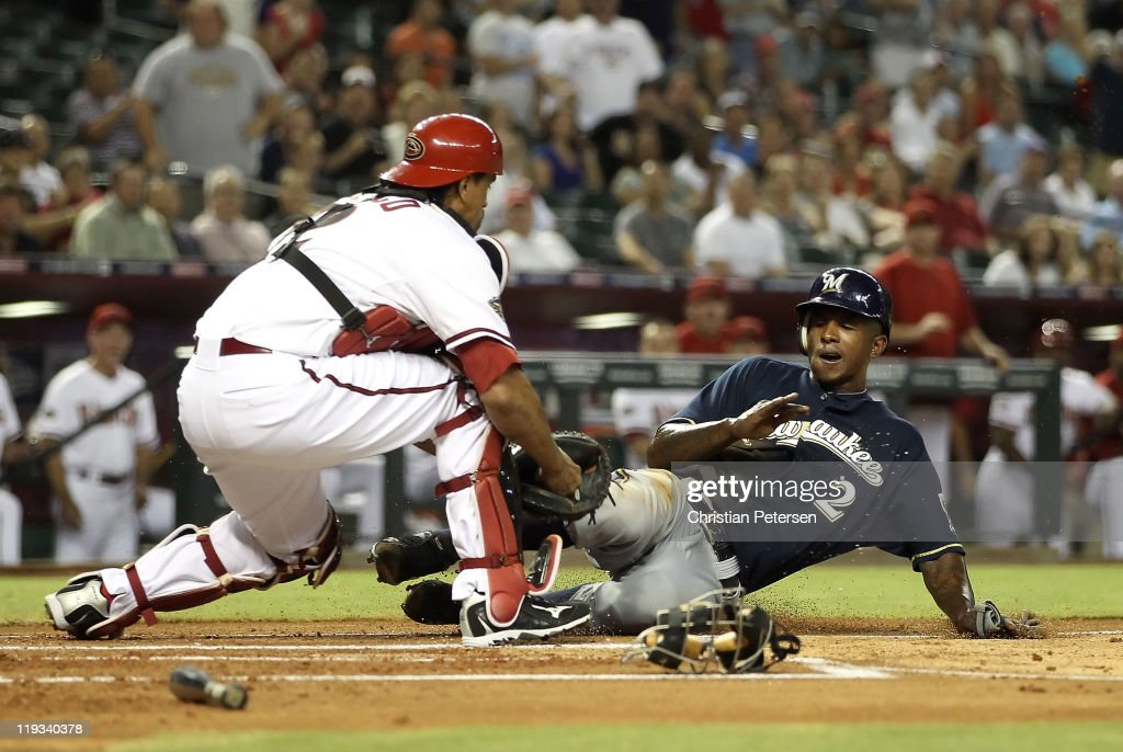 Nyjer Morgan #2 of the Milwaukee Brewers is tagged out by catcher Henry Blanco #12 of the Arizona Diamondbacks as he attempts to score during the first inning of the Major League Baseball game at Chase Field on July 18, 2011 in Phoenix, Arizona.