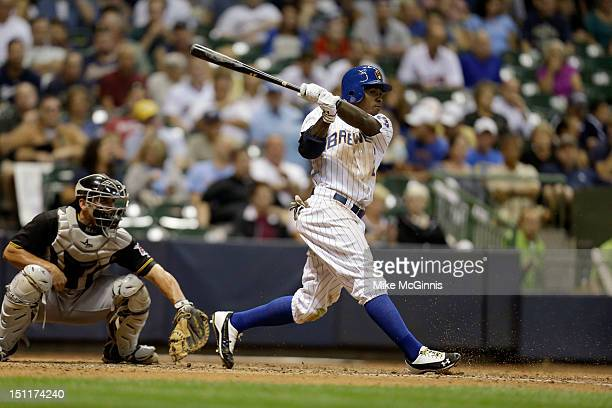 Nyjer Morgan of the Milwaukee Brewers makes some contact at the plate during the game against the Pittsburgh Pirates at Miller Park on August 31 2012...