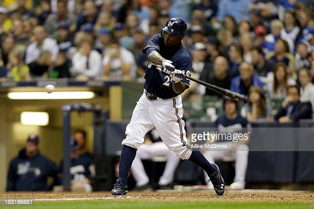 Nyjer Morgan of the Milwaukee Brewers makes some contact at the plate during the game against the Houston Astros at Miller Park on September 29 2012...