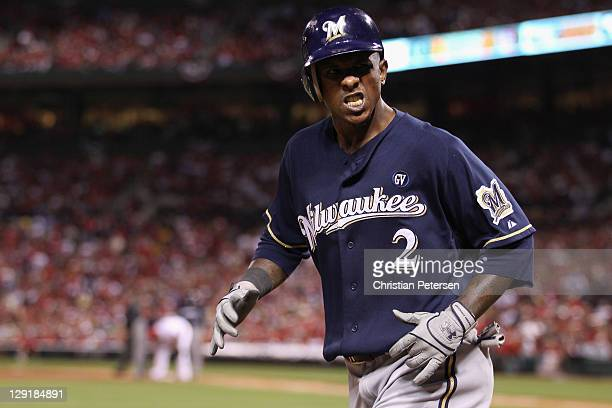 Nyjer Morgan of the Milwaukee Brewers reacts after he scored on a RBI single by Ryan Braun of the Milwaukee Brewers in the top of the fifth inning...