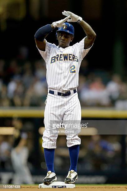 Nyjer Morgan of the Milwaukee Brewers signals for time out after hitting a double against the Pittsburgh Pirates in the bottom of the first inning at...