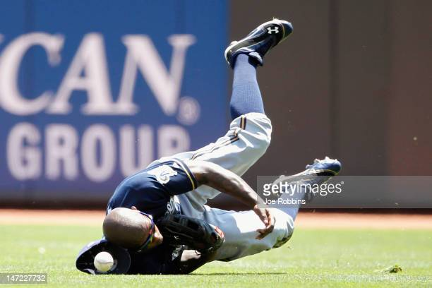 Nyjer Morgan of the Milwaukee Brewers tries to make the catch on a fly ball in right field during the game against the Cincinnati Reds at Great...