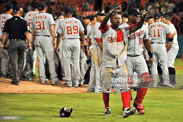 Nyjer Morgan of the Washington Nationals gestures to the crowd as he walks off the field after a brawl during an MLB game against the Florida Marlins...