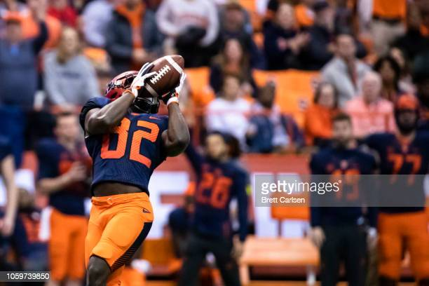 Nykeim Johnson of the Syracuse Orange makes a touchdown reception during the fourth quarter against the Louisville Cardinals at the Carrier Dome on...