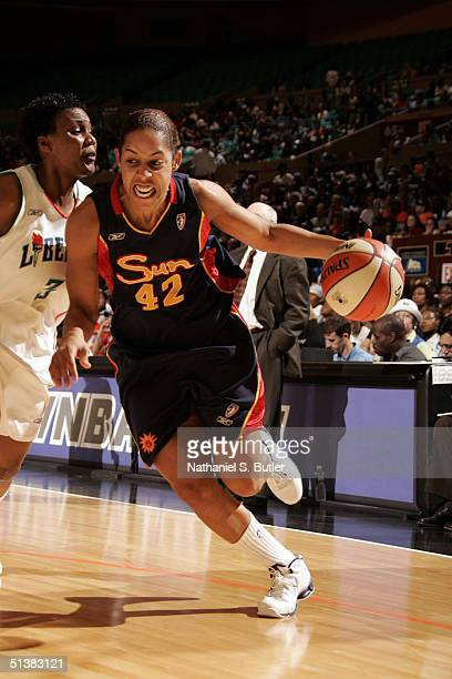 Nykesha Sales of the Connecticut Sun dribbles against Crystal Robinson of the New York Liberty during the 2004 WNBA Eastern Conference Finals on...