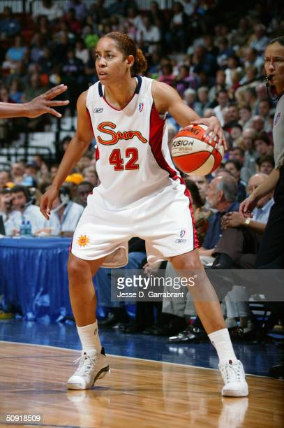 Nykesha Sales of the Connecticut Sun dribbles the ball against the Phoenix Mercury during the game on May 22 2004 at the Mohegan Sun Arena in...
