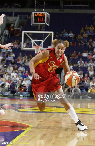 Nykesha Sales of the Phoenix Mercury drives to the basket against the Connecticut Sun during the game at America West Arena on July 19 2003 in...
