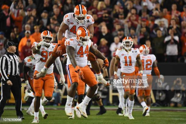 Nyles Pinckney of the Clemson Tigers is congratulated by his teammates after stopping a fake field goal attempt on fourth down by the Alabama Crimson...