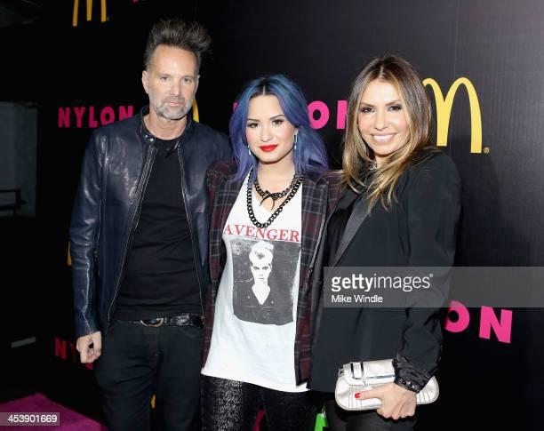 Nylon editorinchief Marvin Scott Jarrett actress Demi Lovato and Nylon publisher Jaclynn Jarrett attend NYLON McDonald's Dec/Jan issue launch party...