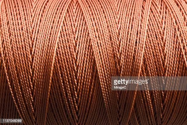 nylon string spool close-up shot - polyester stock photos and pictures
