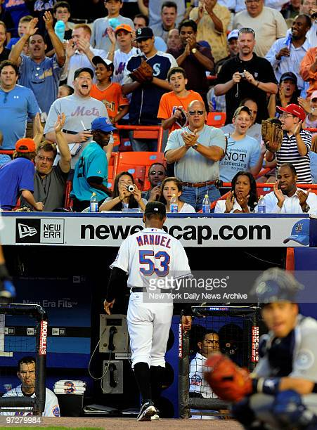 Mets vs Seattle Mariners at Shea Stadium., New York Mets center fielder Carlos Beltran questions home plate umpire Brian Runge in the 4th inning....