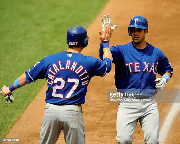 Mets vs Texas Rangers at Shea Stadium. Rangers Ramon Vazquez hits a 3 run homer off of Mets pitcher John Maine in the 5th inning. Rangers lead 3-1....