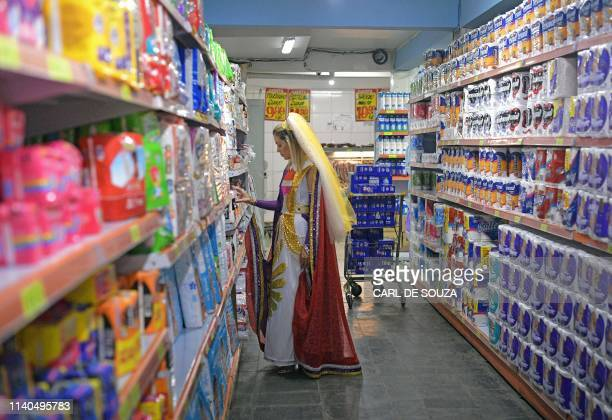 A Nymph a female devotee of the Vale do Amanhecer religious community shops at a store in Vale do Amanhecer a community on the outskirts of...