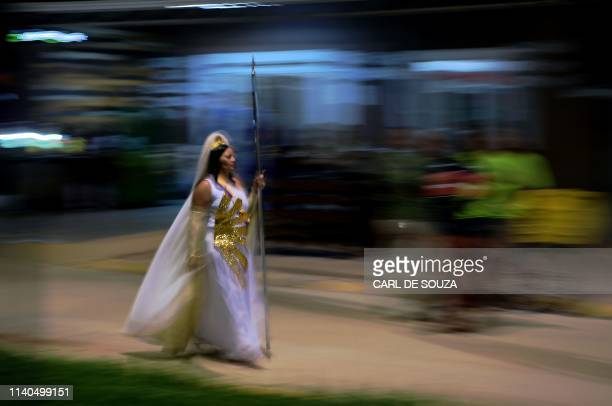 Nymph, a female devotee of the Vale do Amanhecer religious community, walks to a ceremony in Vale do Amanhecer, a community on the outskirts of...