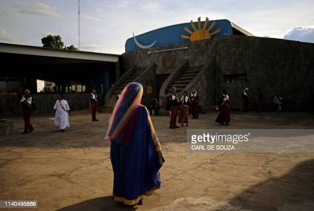 A Nymph a female devotees of the Vale do Amanhecer religious community heads to the temple complex in Vale do Amanhecer a community on the outskirts...