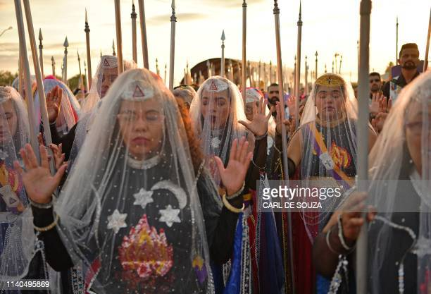 Nymphs female devotees of the Vale do Amanhecer religious community pray during their biggest ceremony of the year at their temple complex in Vale do...