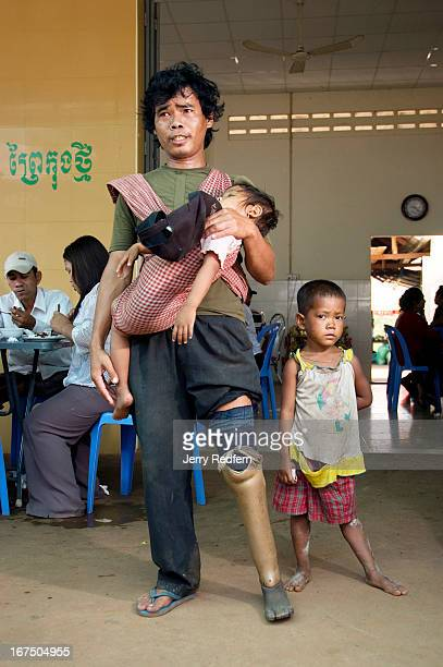 Nyol a former soldier who stepped on a landmine begs at a truck stop with two girls he calls his daughters He calls the older Towit and says she is...