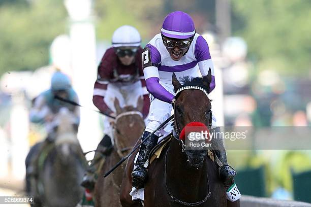 Nyquist ridden by Mario Gutierrez crosses the finish line during the 142nd running of the Kentucky Derby at Churchill Downs on May 07 2016 in...