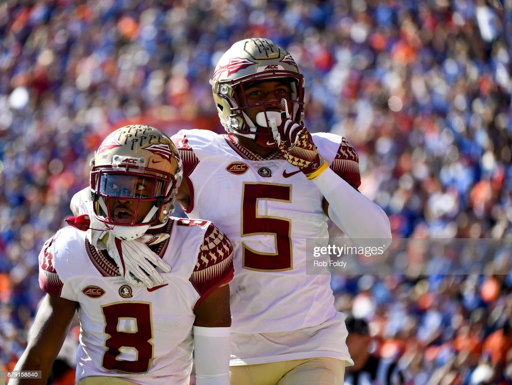 Nyqwan Murray #8 and Da'Vante Phillips #5 of the Florida State Seminoles react after an FSU touchdown during the first half of the game against the Florida Gators at Ben Hill Griffin Stadium on November 25, 2017 in Gainesville, Florida.