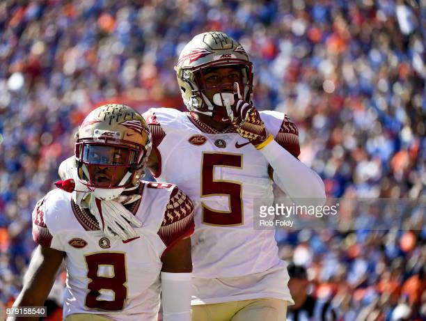 Nyqwan Murray and Da'Vante Phillips of the Florida State Seminoles react after an FSU touchdown during the first half of the game against the Florida...