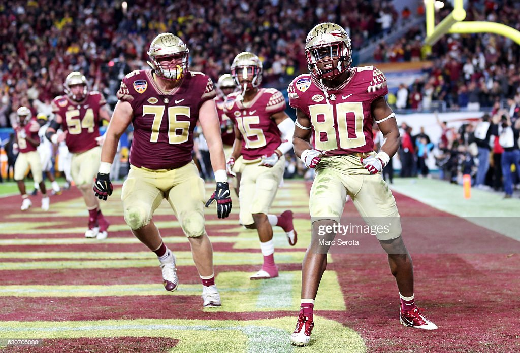 Nyqwan Murray #80 of the Florida State Seminoles scores a touchdown in the fourth quarter against the Michigan Wolverines during the Capitol One Orange Bowl at Sun Life Stadium on December 30, 2016 in Miami Gardens, Florida.