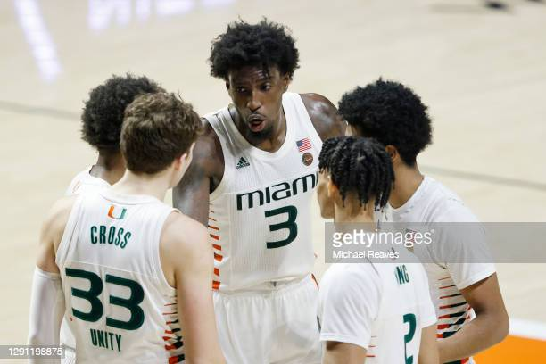 Nysier Brooks of the Miami Hurricanes talks with the team during a huddle against the Purdue Boilermakers during the second half at Watsco Center on...